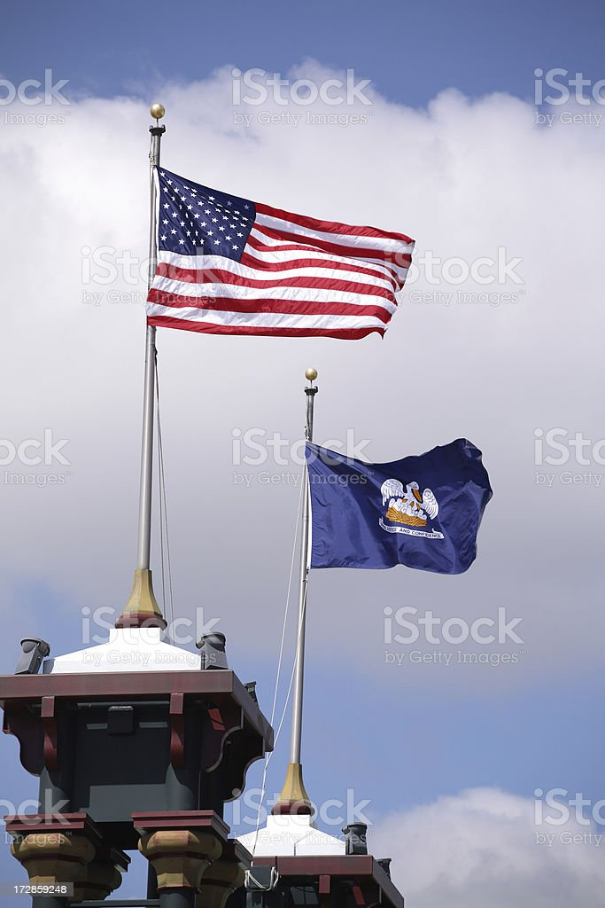 United States and Louisiana State flags royalty-free stock photo