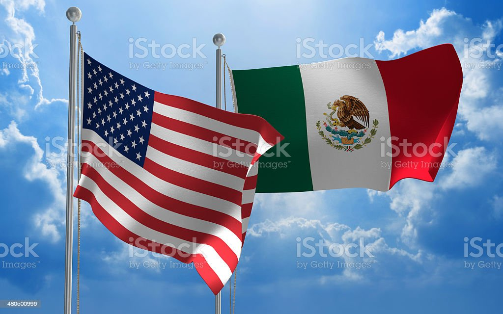United States and Mexico flags flying together for diplomatic talks stock photo