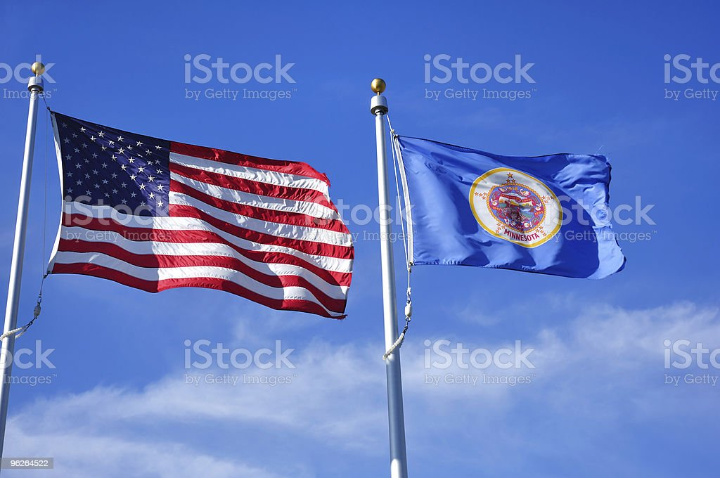 United States and Minnesota State Flags stock photo