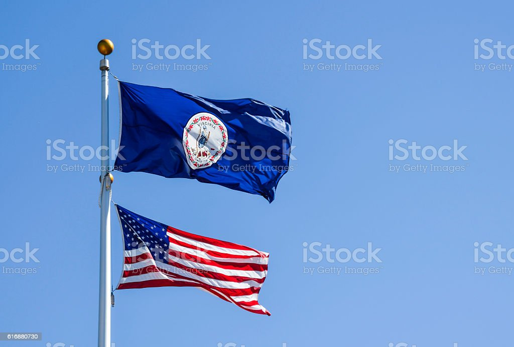United States and Virginia Flags on Poles stock photo