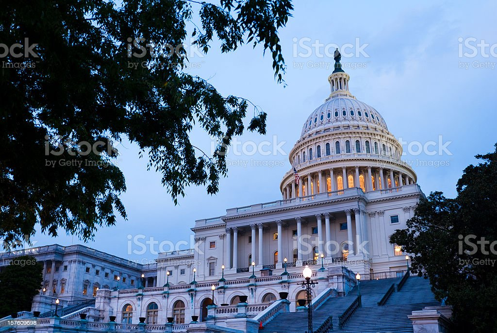 United States Capitol building in Washington DC at night time stock photo