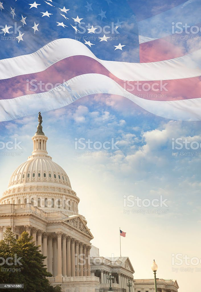 United States Capitol building with American flag superimposed on sky stock photo
