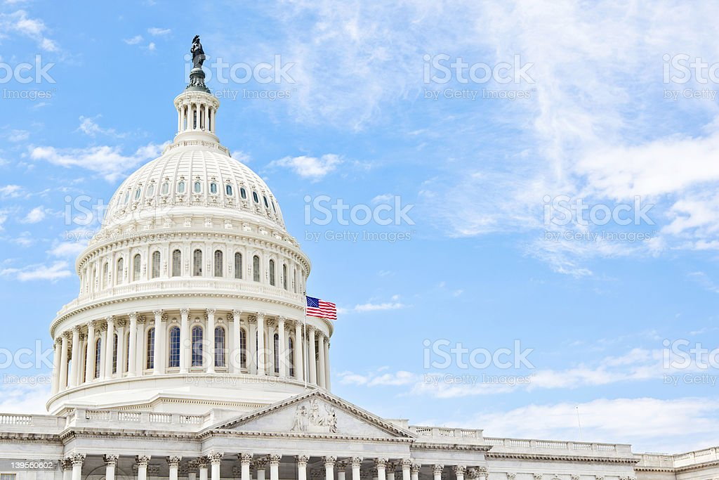 United States Capitol dome against a blue sky stock photo