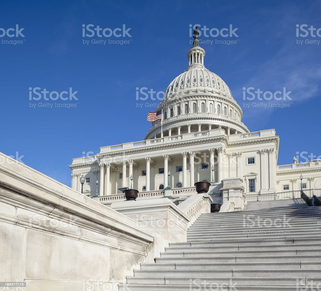 United States Capitol West Facade Featuring Long Stairway and Flag royalty-free stock photo
