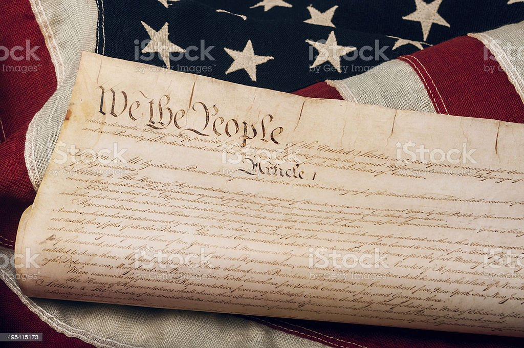 United States Constitution on an American flag stock photo