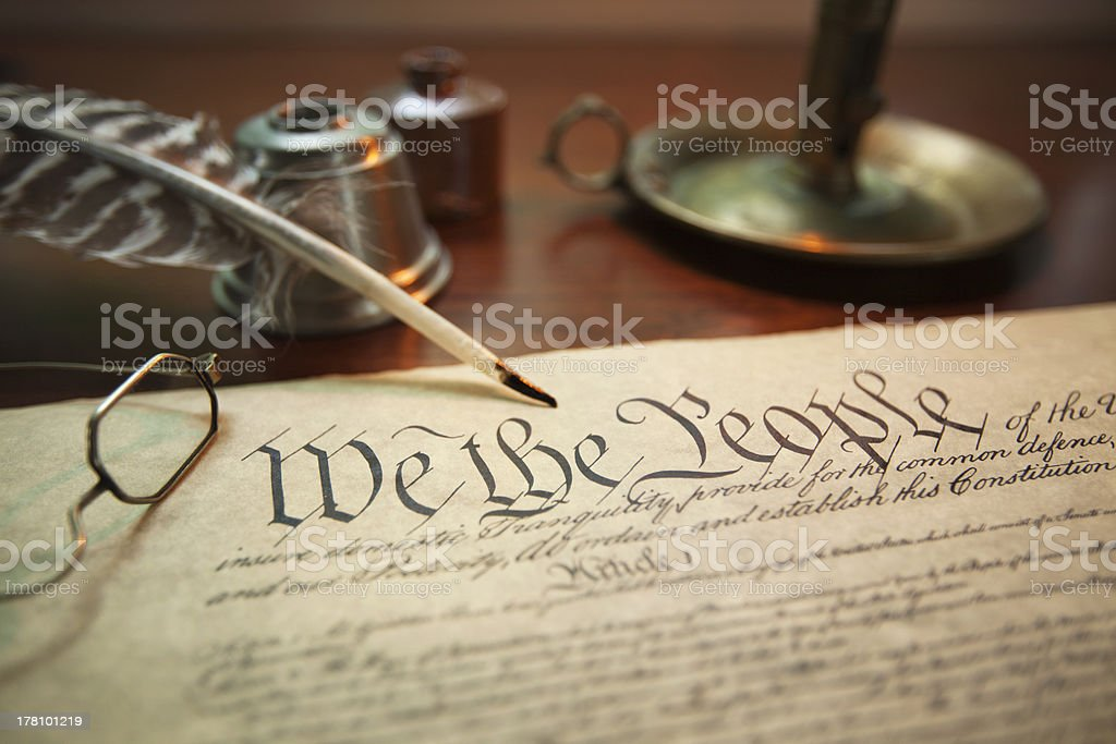 United States Constitution with quill, glasses and candle holder stock photo