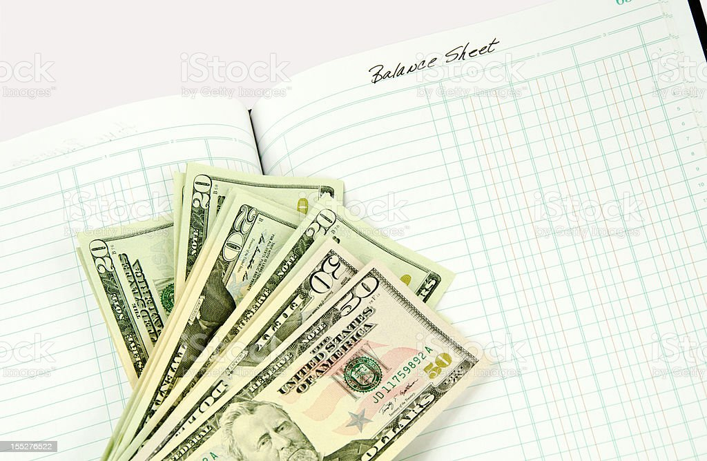 United States Currency on Account Book royalty-free stock photo