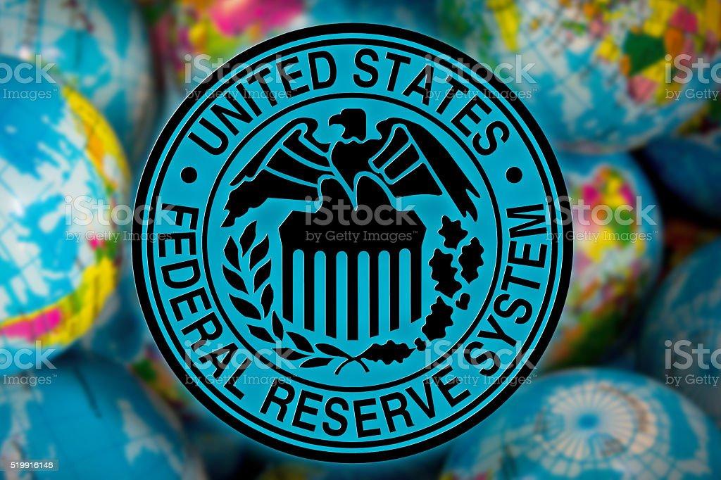 United States Federal Reserve System symbol (FED) on globe background, stock photo