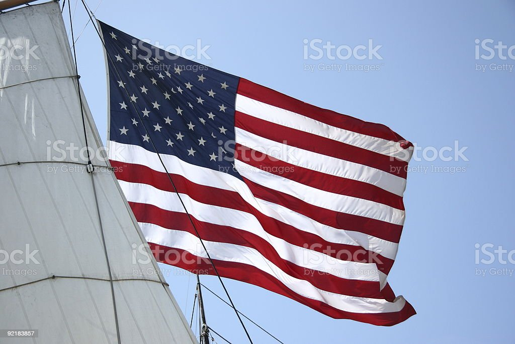 United States Flag with Ship Sail stock photo