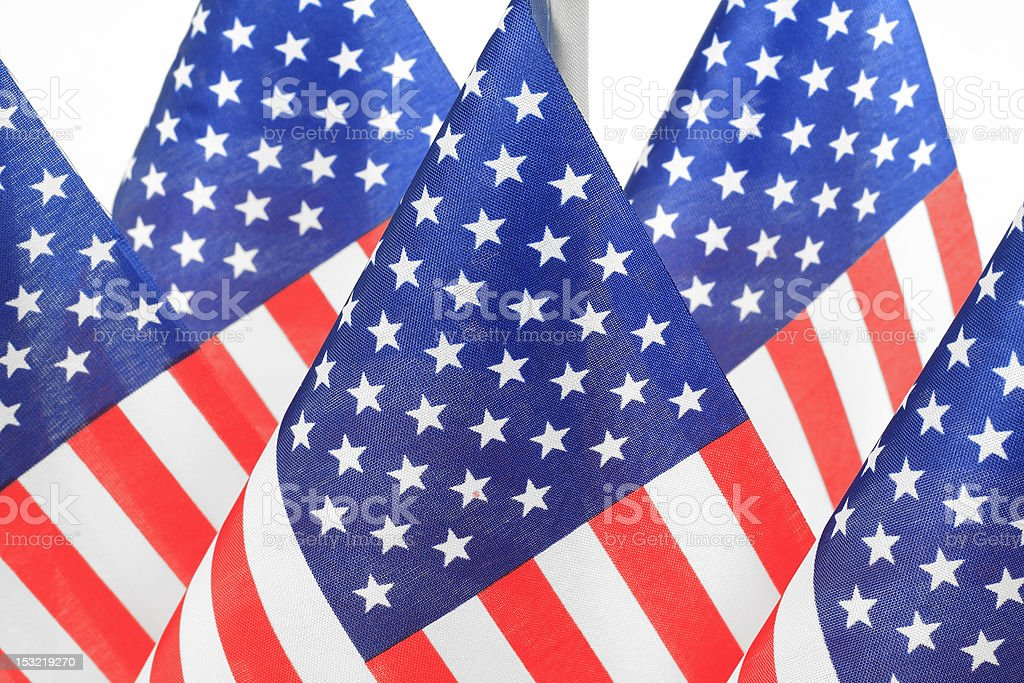 United States flags hanging in the queue on flagpole stock photo