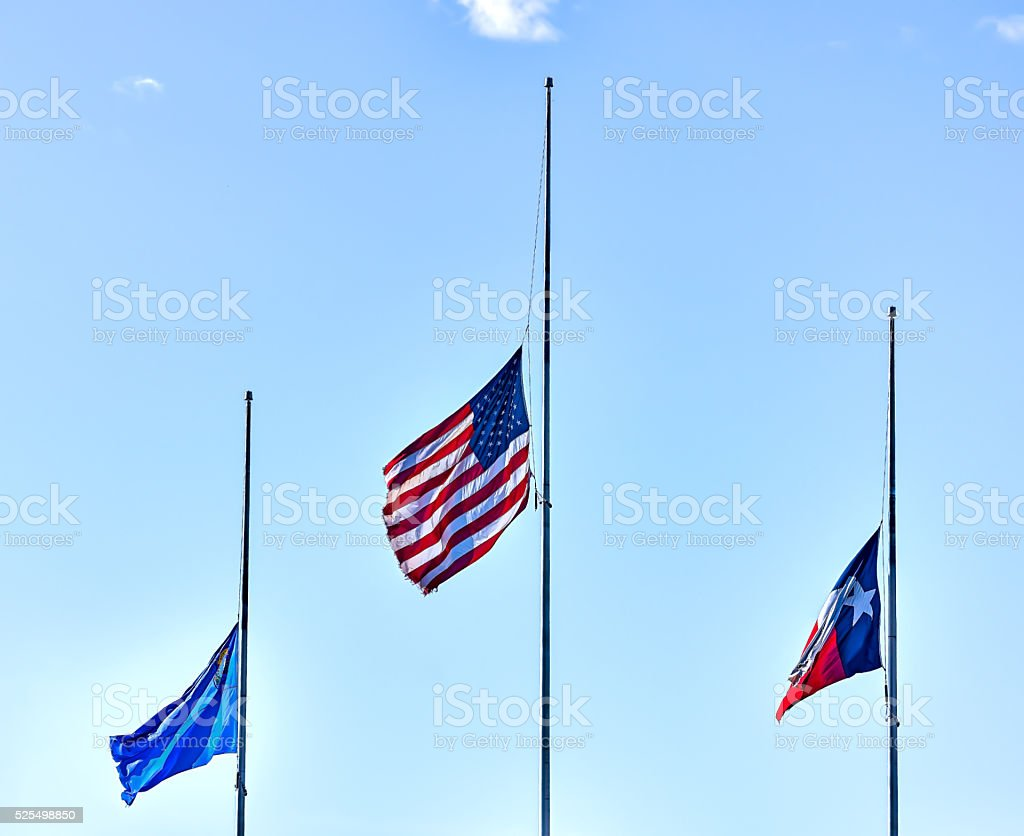 United States, Nevada and Texas flags flying at half staff. stock photo