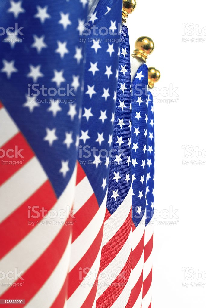 United States of America flags hanging on the gold flagpole stock photo