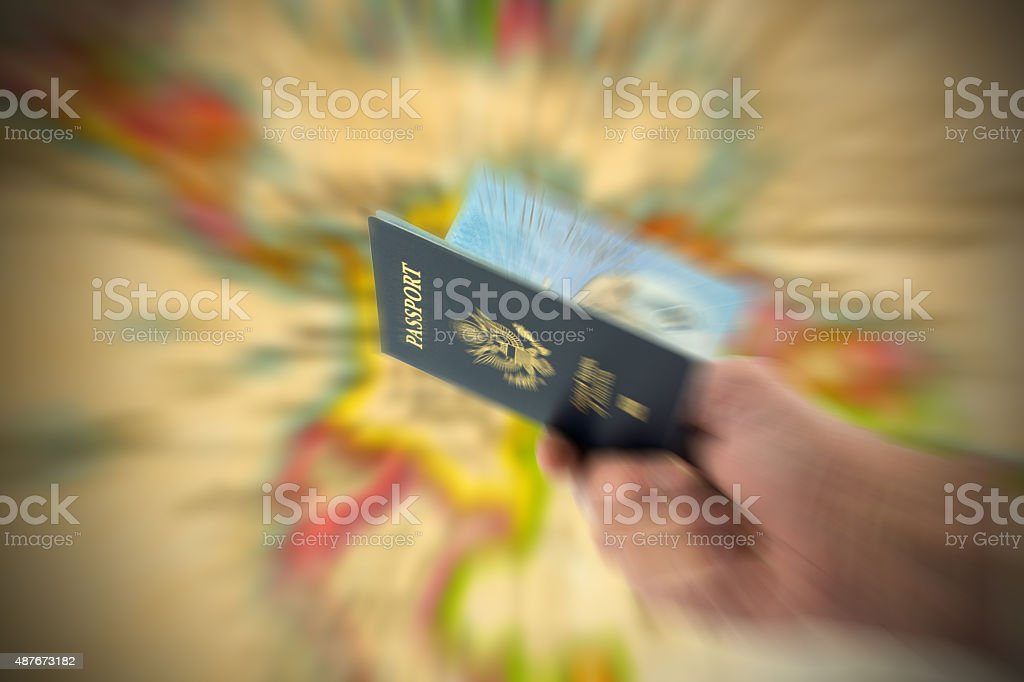 United States passport hand held and map- zoom effect stock photo