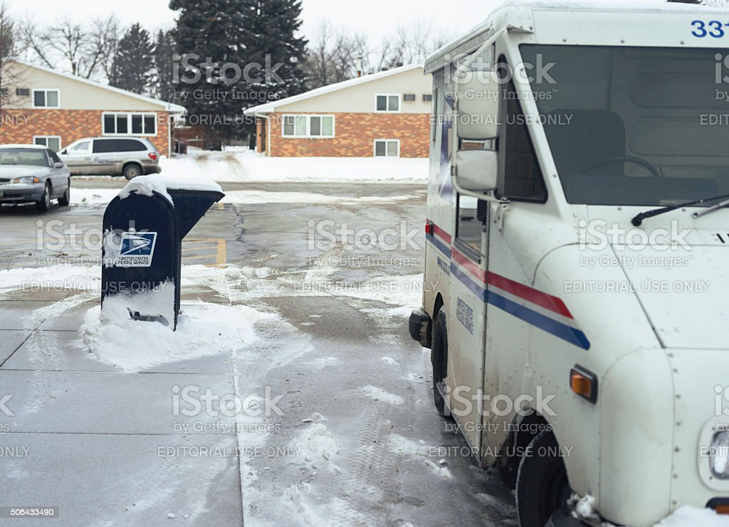United States Postal Service delivery truck during winter stock photo