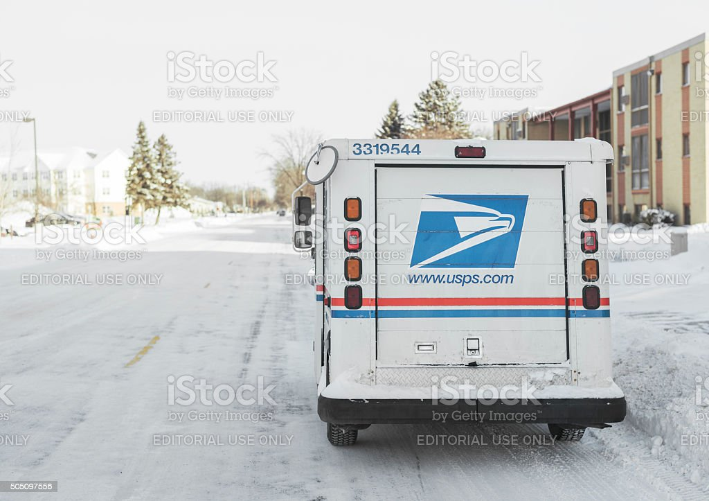 United States Postal Service van parked on icy street stock photo