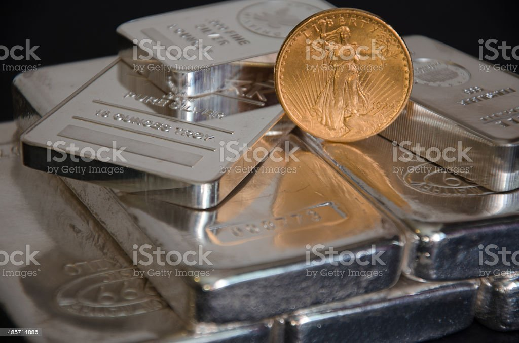 United States Saint-Gaudens Gold coins on SIlver Bars stock photo