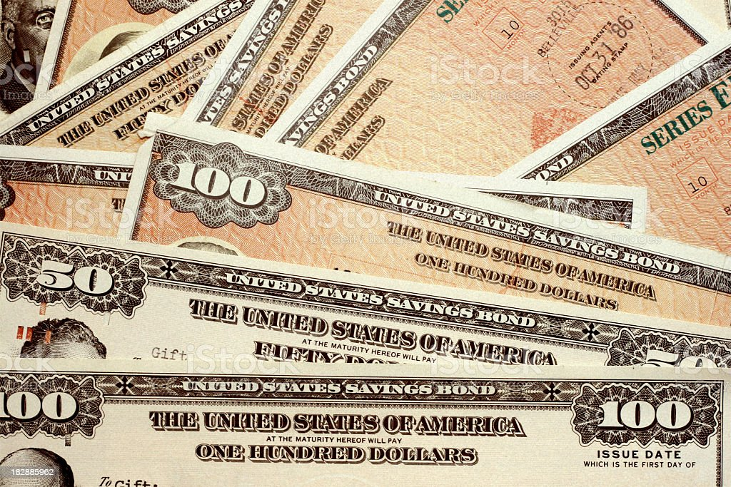 United States savings bonds of varying amounts stock photo