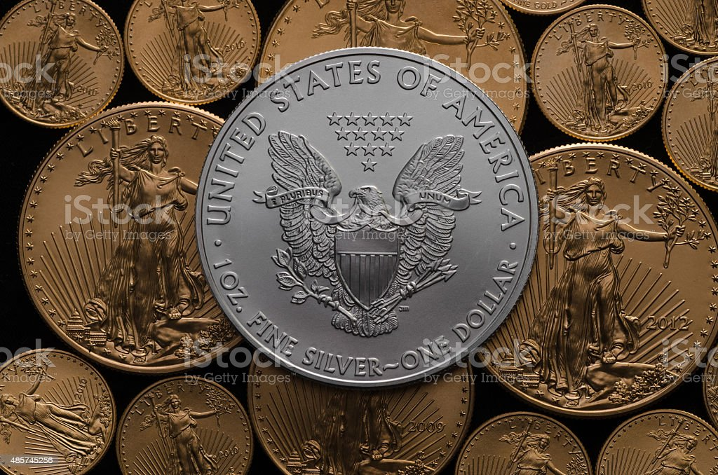 United States Silver Eagle Coin on American Gold Eagles stock photo