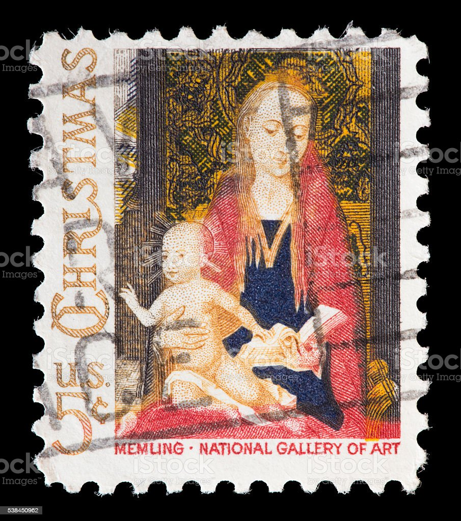 United States used postage stamp showing religious painting, Hans Memling stock photo