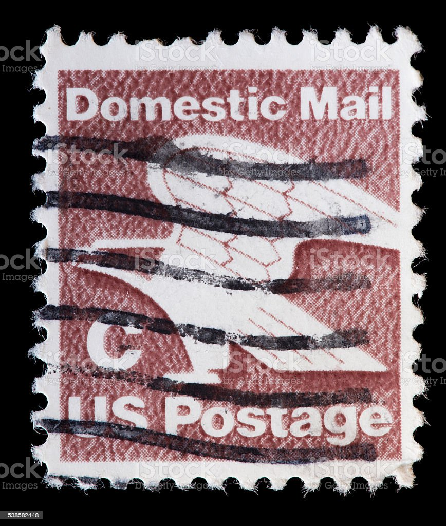 United States used postage stamp showing stylized eagle Domestic Mail stock photo