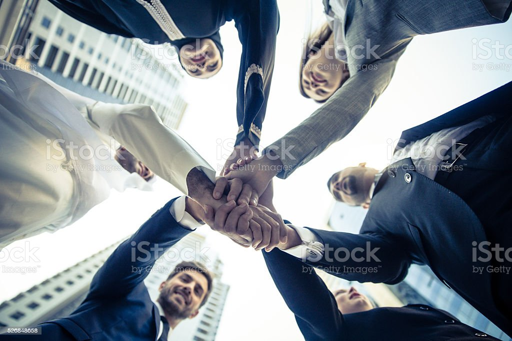 Unity between multicultural business professional stock photo