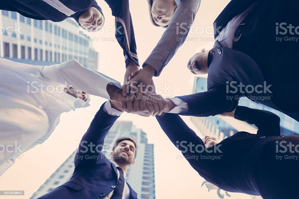 Unity between multicultural business professionals stock photo