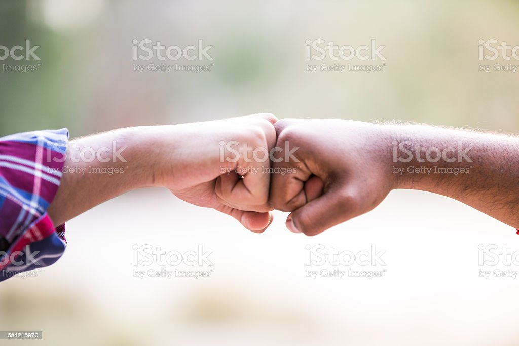 Unity in Diversity - Bond Sealed with a Fist Bump stock photo