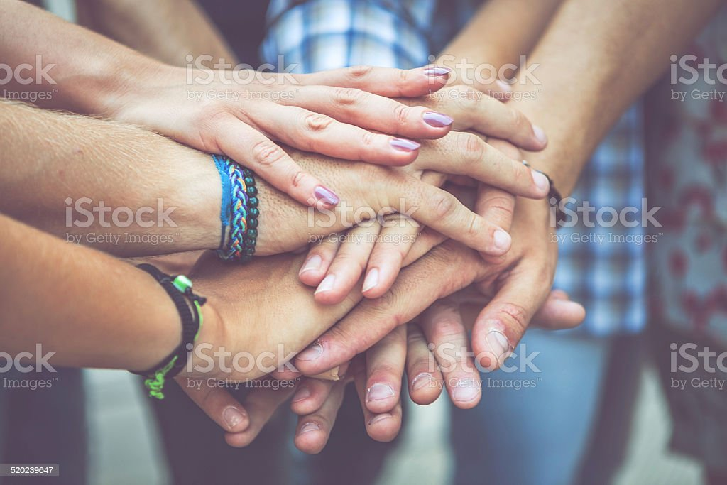Unity oath pile of hands stock photo