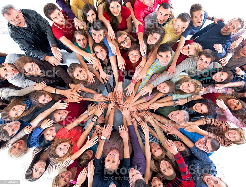Unity of large group of happy people looking at camera. stock photo