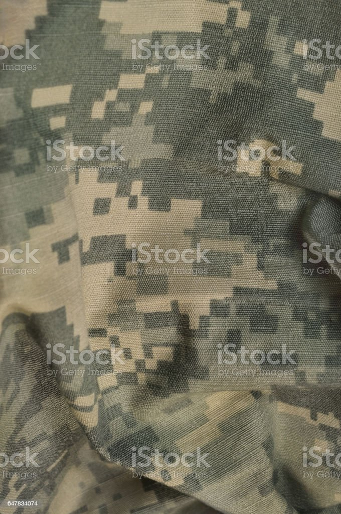 Universal camouflage pattern, army combat uniform digital camo, USA military ACU macro closeup, rip-stop fabric texture background, crumpled, wrinkled, foliage green, yellow desert tan, urban grey NYCO, nylon, cotton, vertical stock photo
