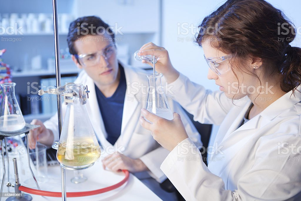 University Chemistry Laboratory Research Students Working in Class Together stock photo