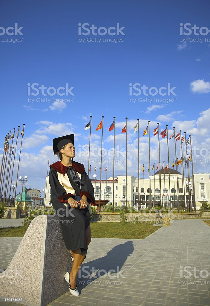 University graduate with a book royalty-free stock photo