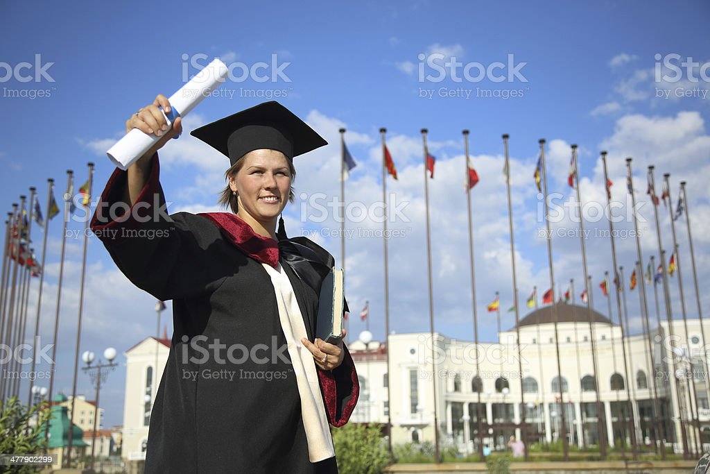 University graduate with a diploma royalty-free stock photo