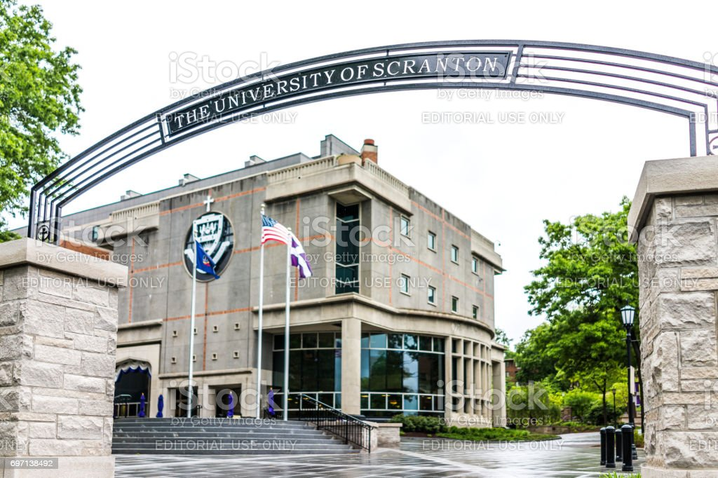 University of Scranton library building with sign and entrance and flags stock photo