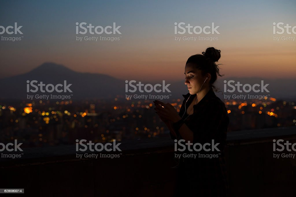 University student at dusk in Yerevan, Armenia stock photo