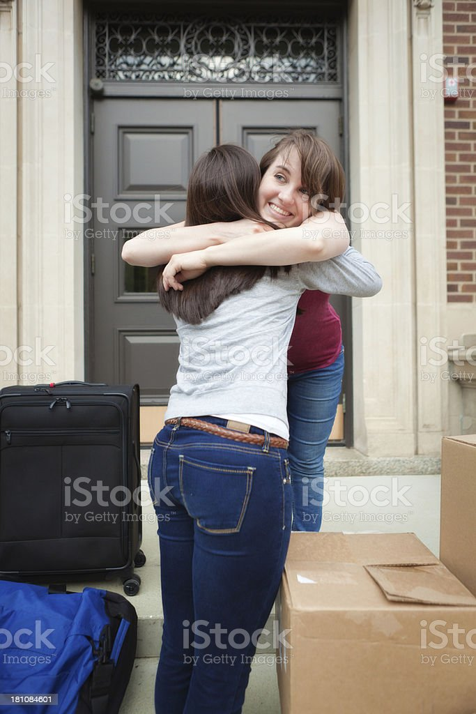 University Student Friends Greeting While Moving Dormitory Vertical royalty-free stock photo