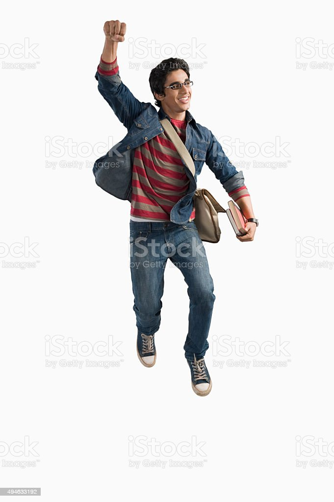 University student jumping in excitement stock photo