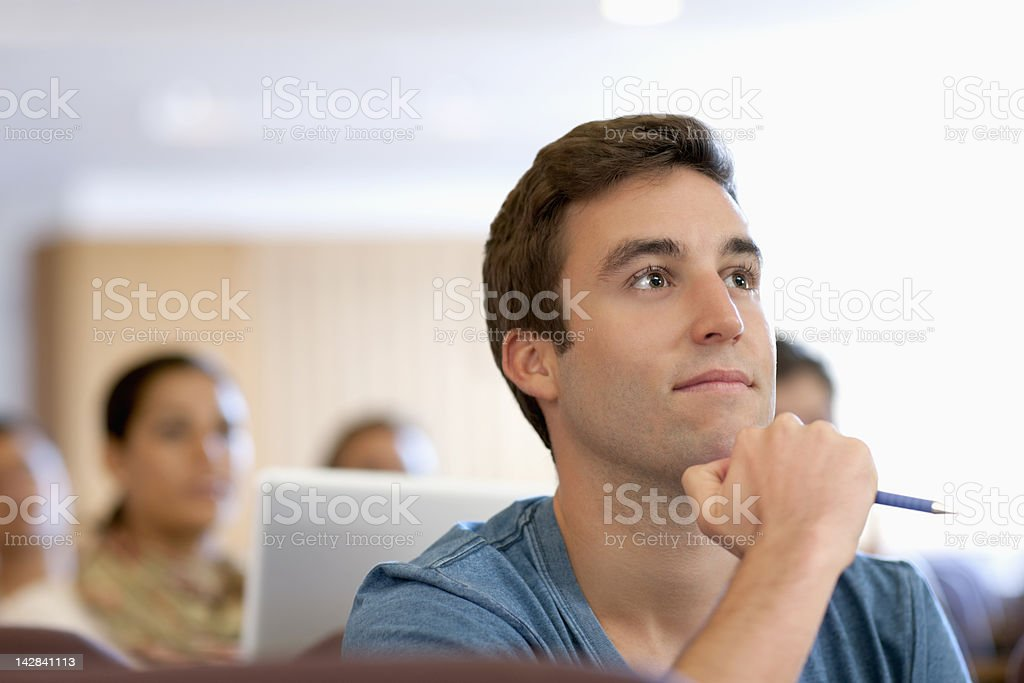 University student listening in lecture hall royalty-free stock photo