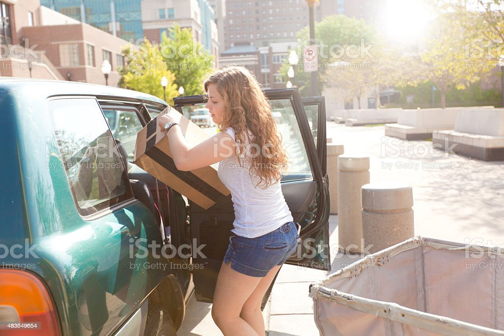 University Student Moving Relocating Dormitory Apartment stock photo