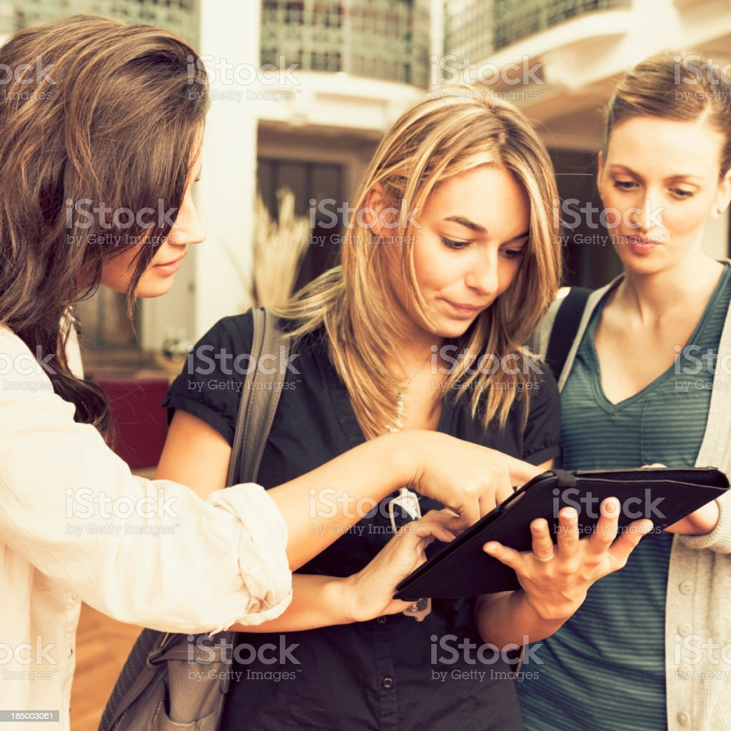 University student with digital tablet in a library royalty-free stock photo