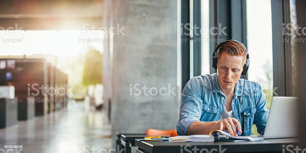 University student working on academic assignment stock photo