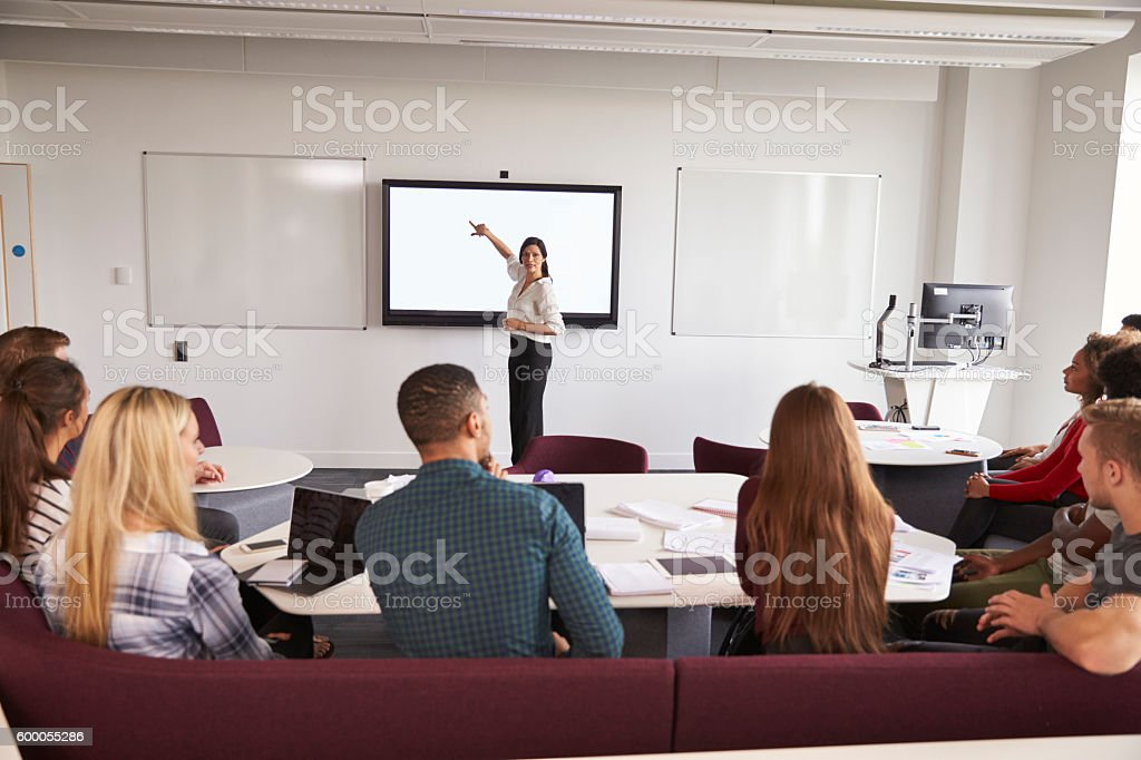 University Students Attending Lecture On Campus stock photo