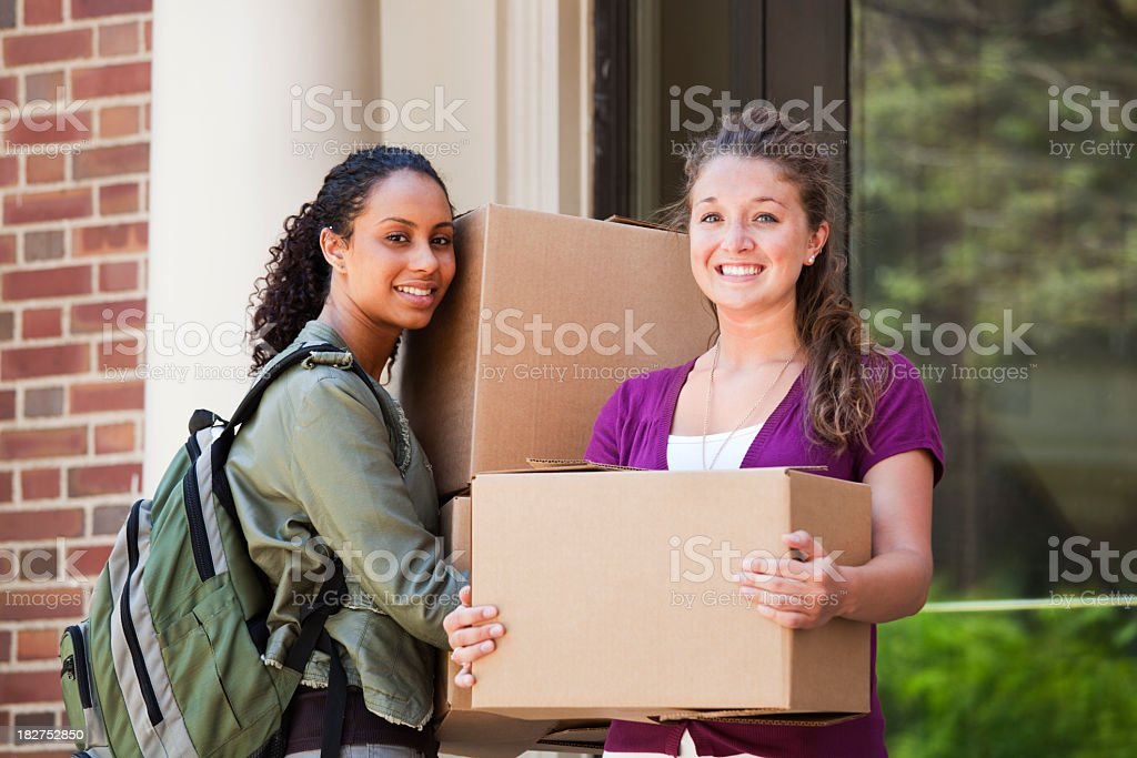 University Students Carrying Boxes, Moving to College Campus Dormitory Apartment royalty-free stock photo