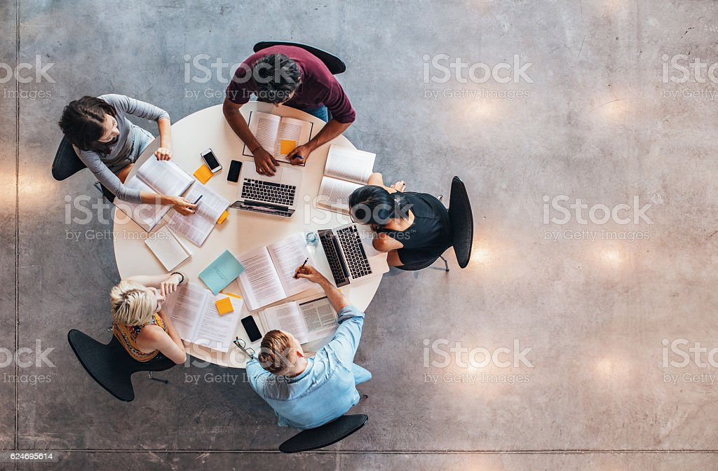 University students doing group study stock photo
