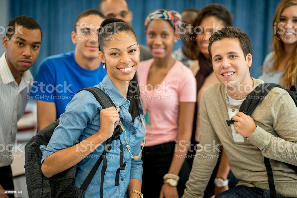 University Students Holding Backpacks stock photo