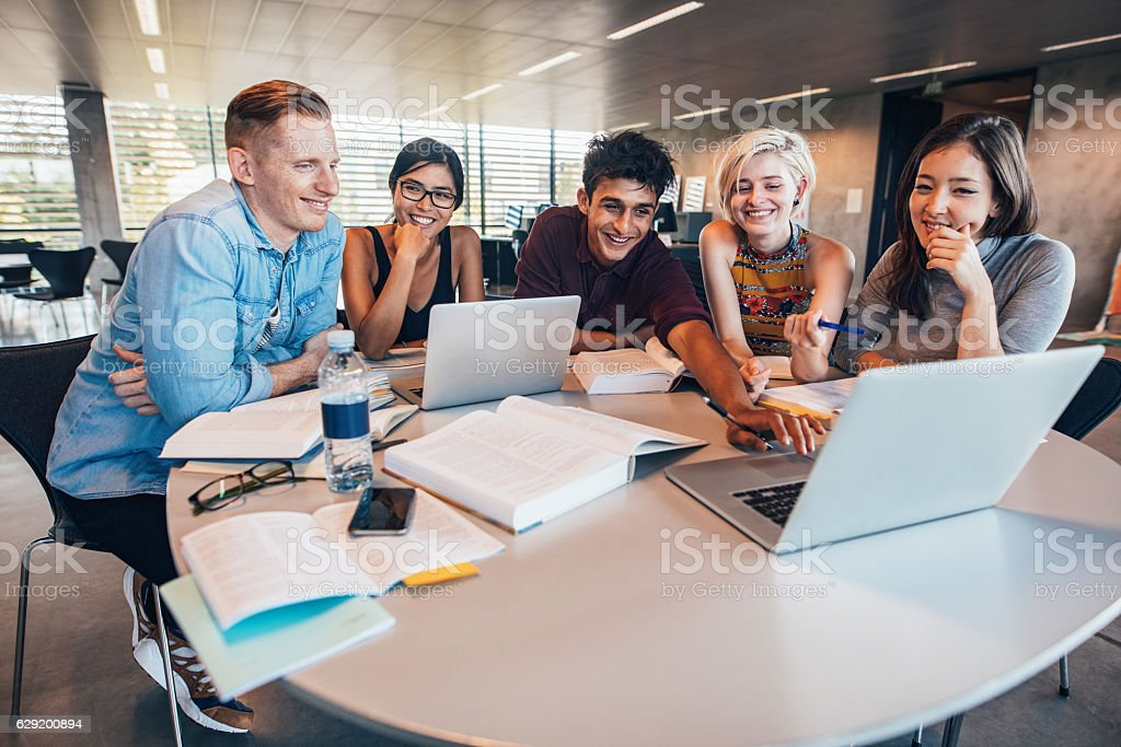 University students in cooperation with their assignment stock photo
