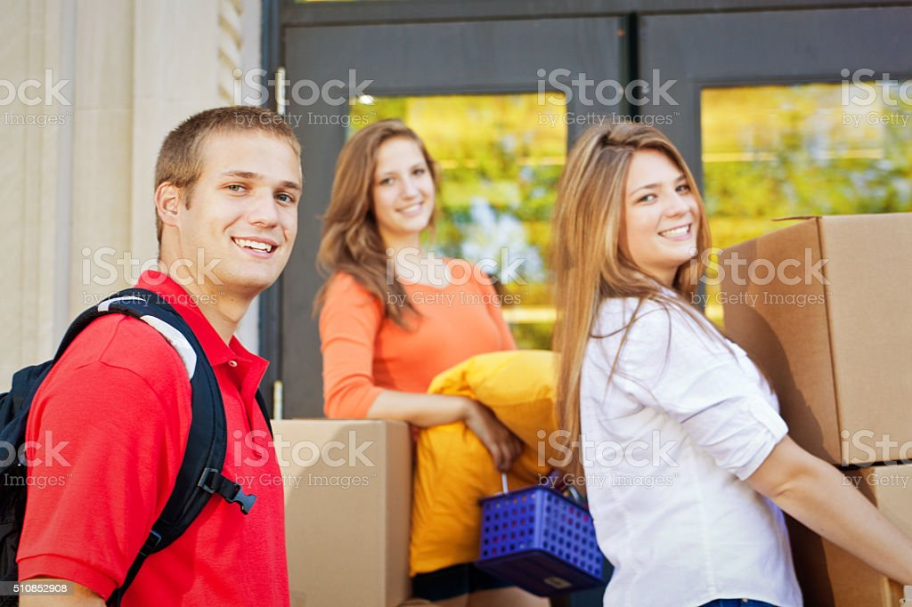 University Students Moving College Dorm Apartment on University Campus stock photo