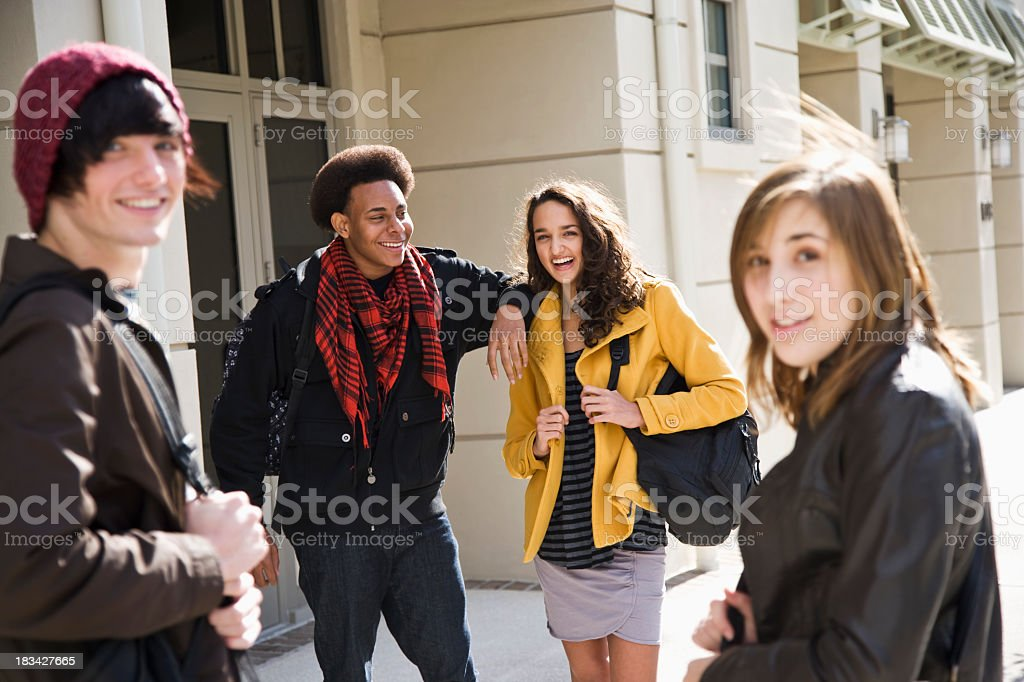 University students on campus carrying bookbags royalty-free stock photo