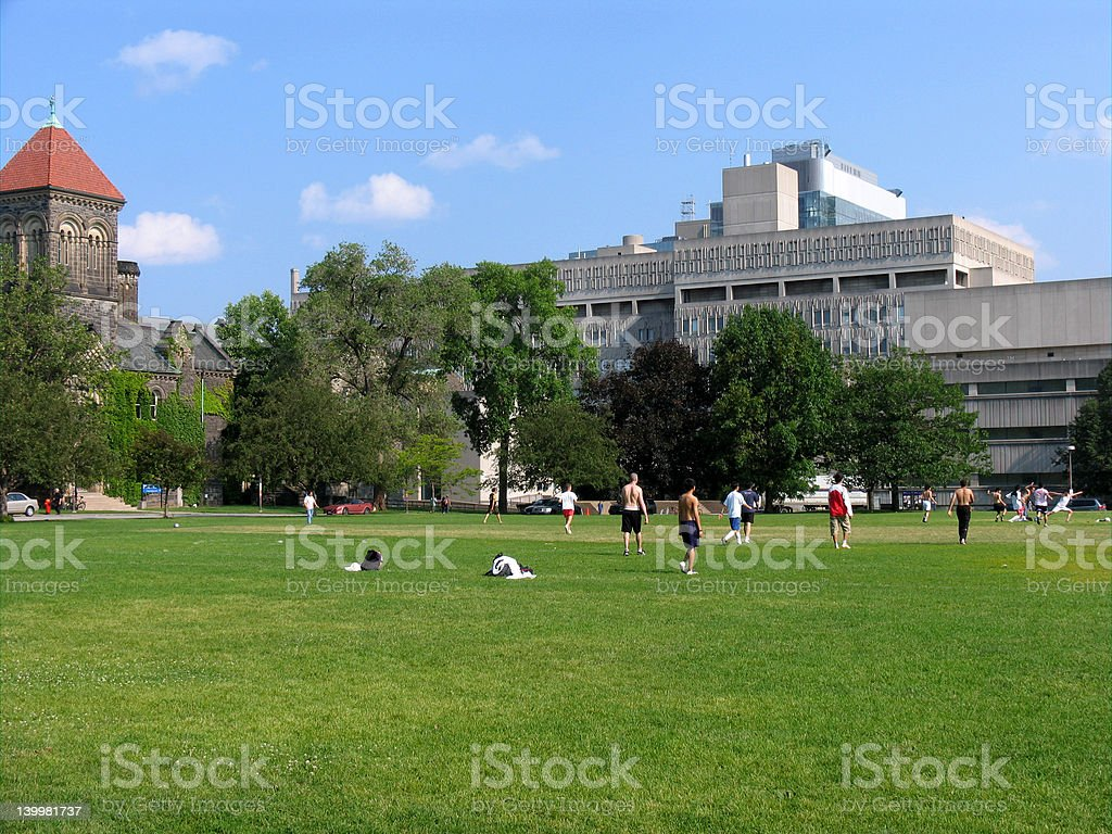 University students playing soccer stock photo