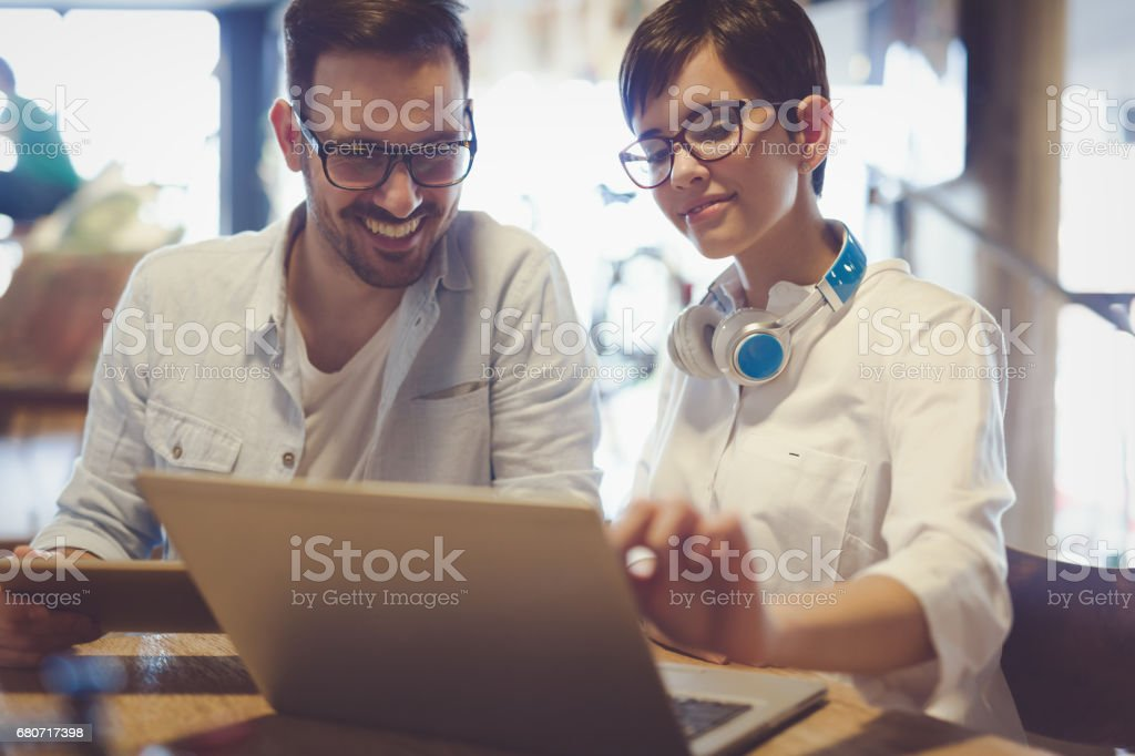 Smart University students studying for exams on laptop